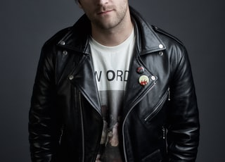 man in black leather jacket