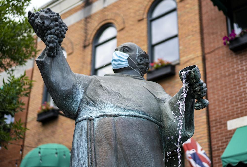 man in black suit statue