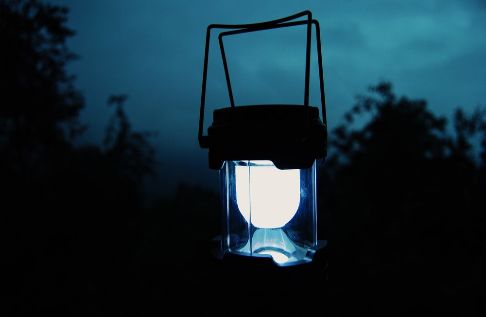 clear glass lamp turned on during night time