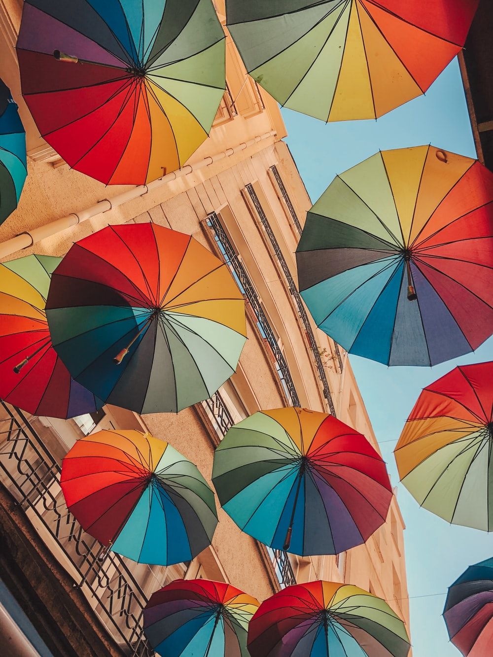 low angle photography of umbrella umbrellas under blue sky during daytime