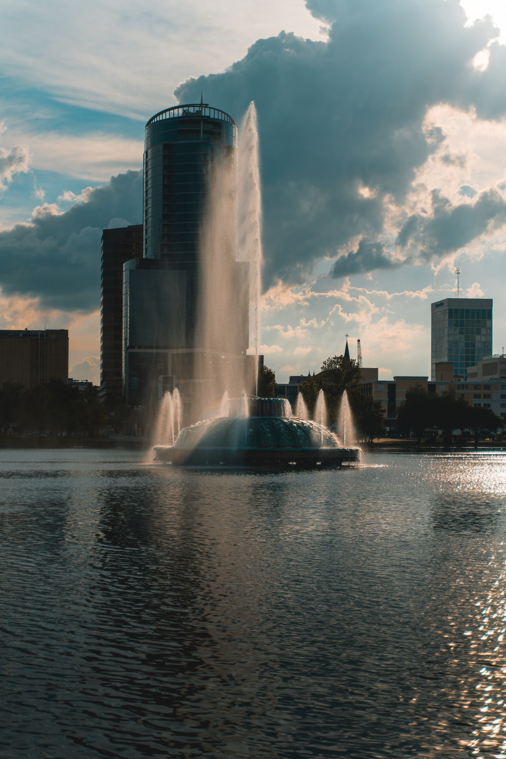 water fountain near city buildings during daytime