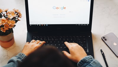 person using black laptop computer google teams background