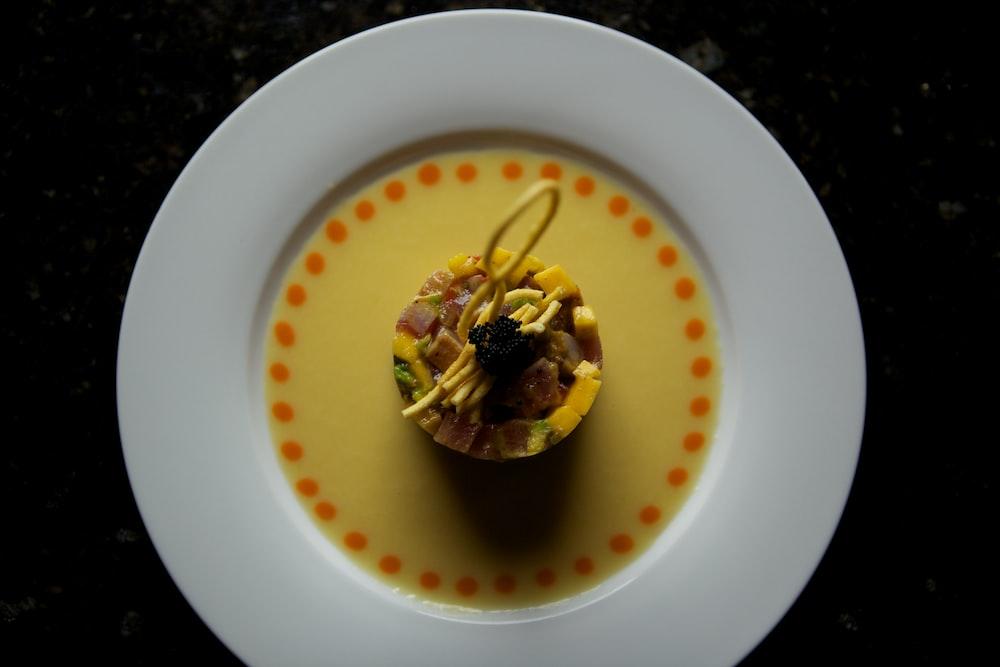 yellow liquid in white ceramic bowl