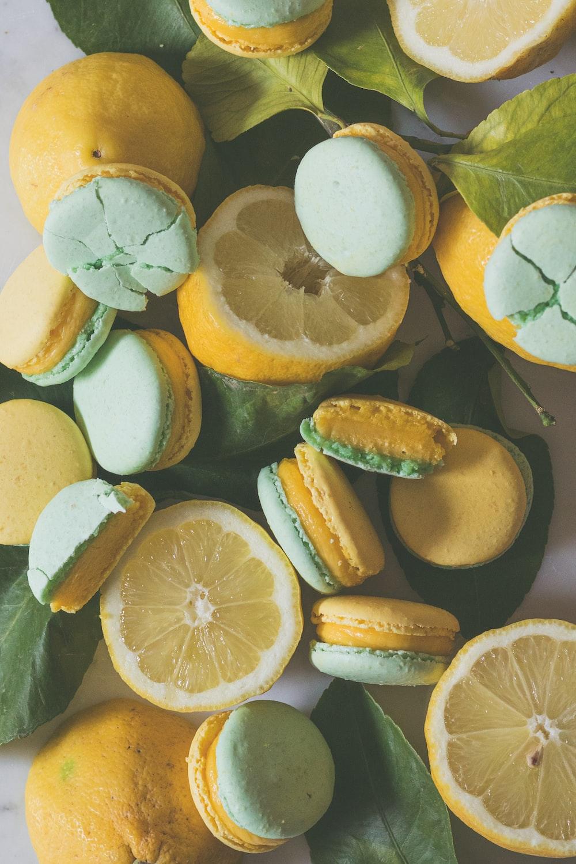 sliced lemon and green lemon on water