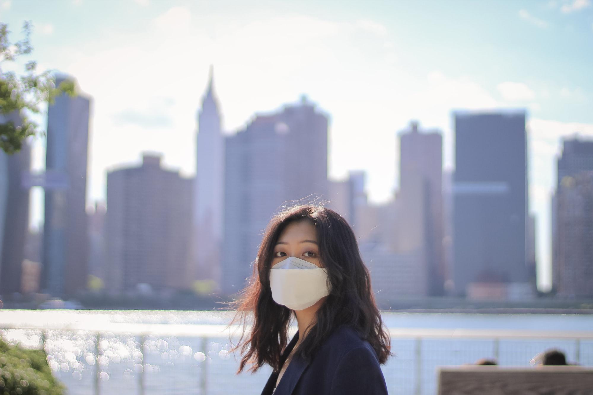 Model IG @esthermjo wearing mask front of NYC skyline