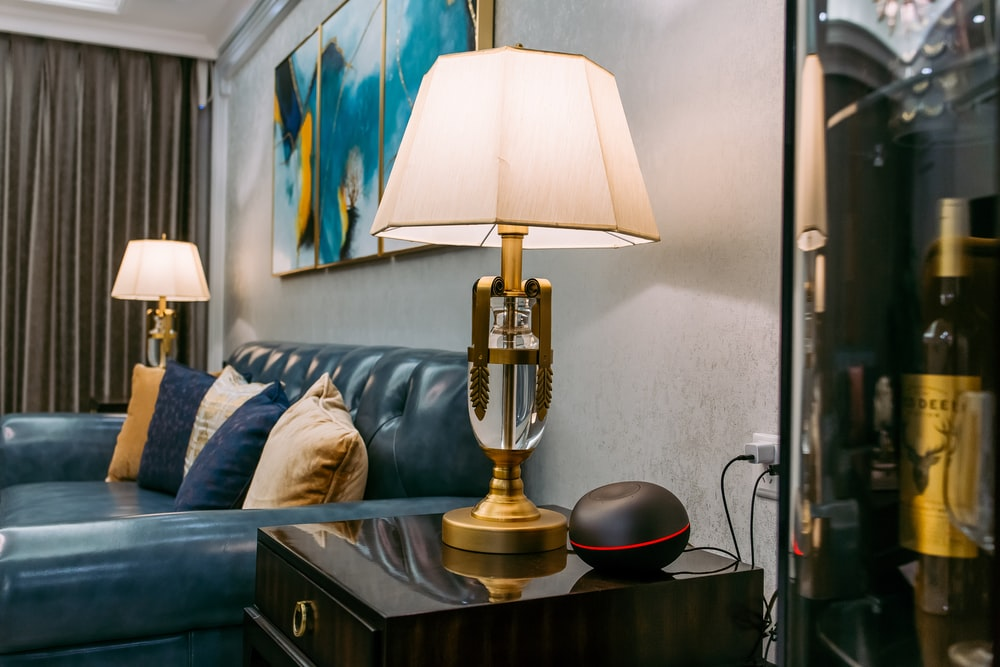 brass and white table lamp on brown wooden table