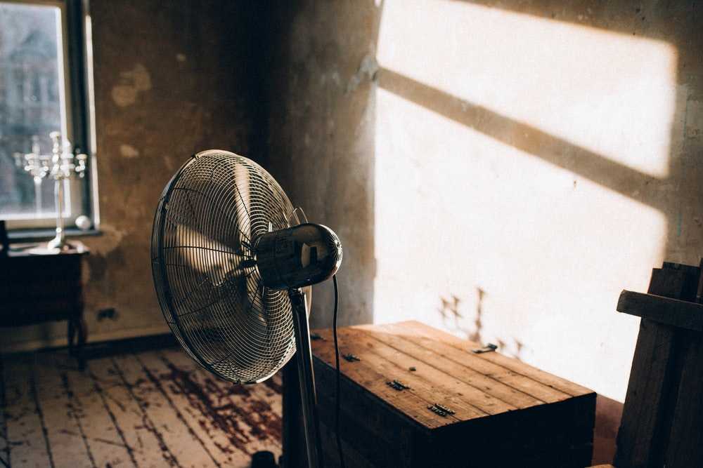 black and white stand fan