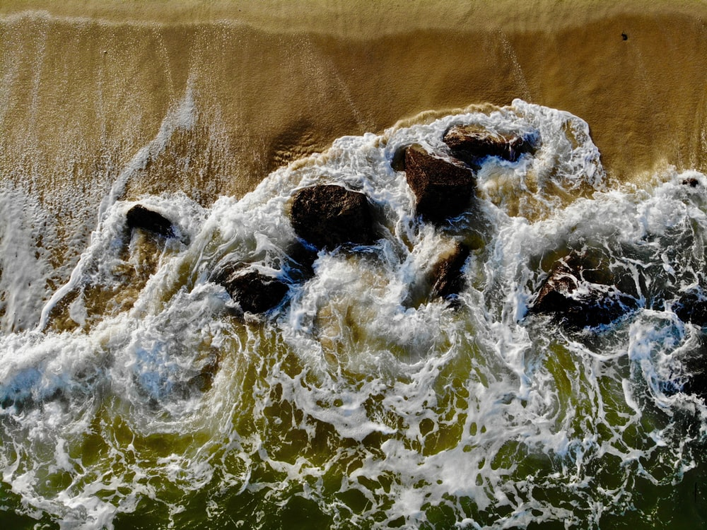 water waves on brown sand