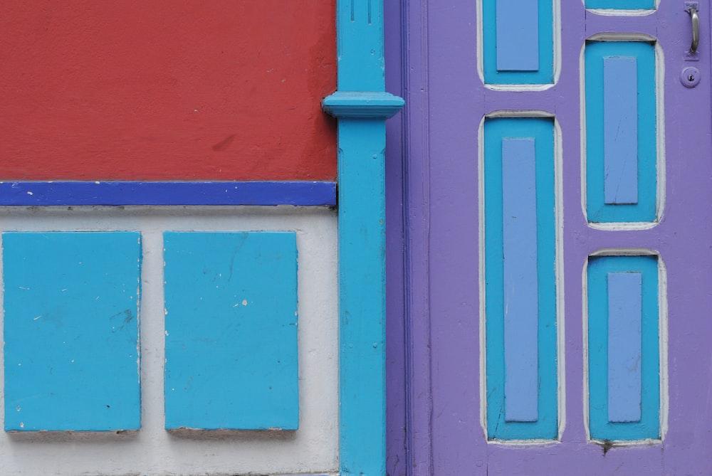 blue and red wooden door