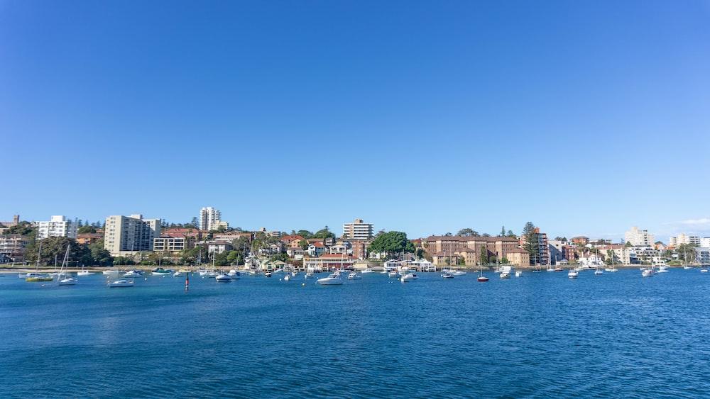 city skyline across blue sea under blue sky during daytime