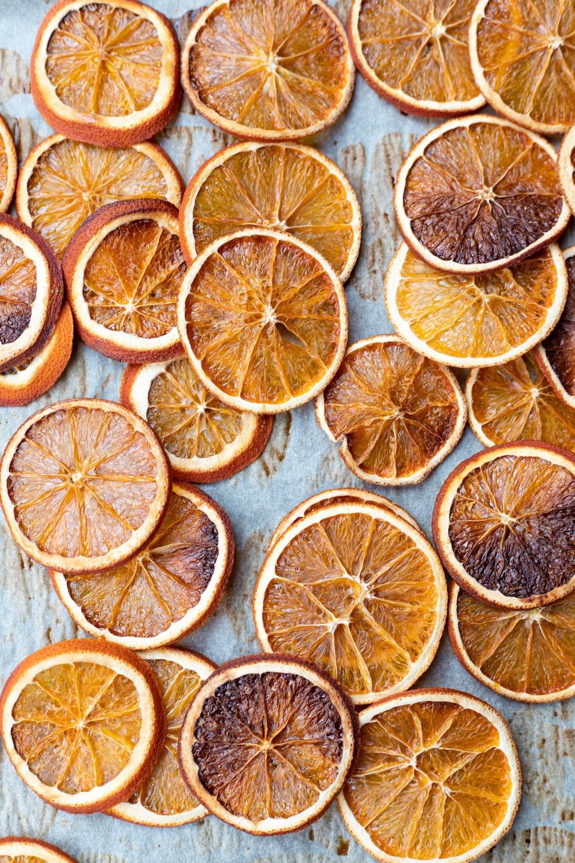 sliced orange fruits on white wooden table