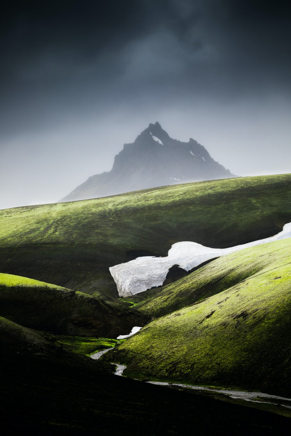 green grass field and mountain