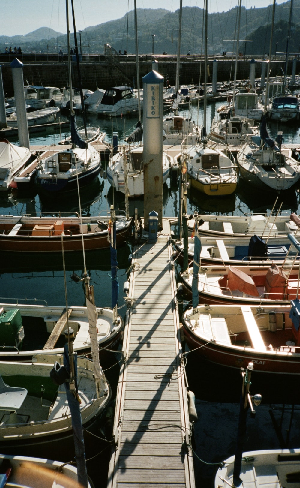 white and brown boat on dock during daytime