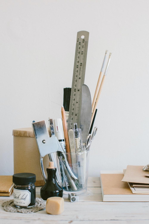 brown wooden handled scissors and pencils