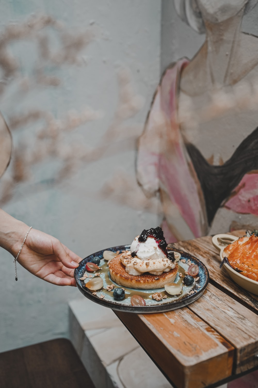 person holding a plate with cake