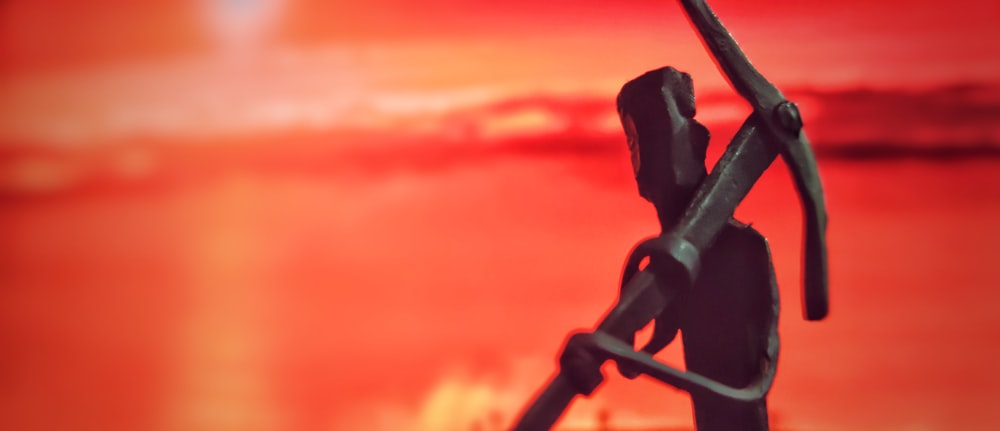 black metal rod with red background