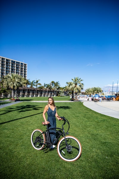 Riding an electric bike by the beach.