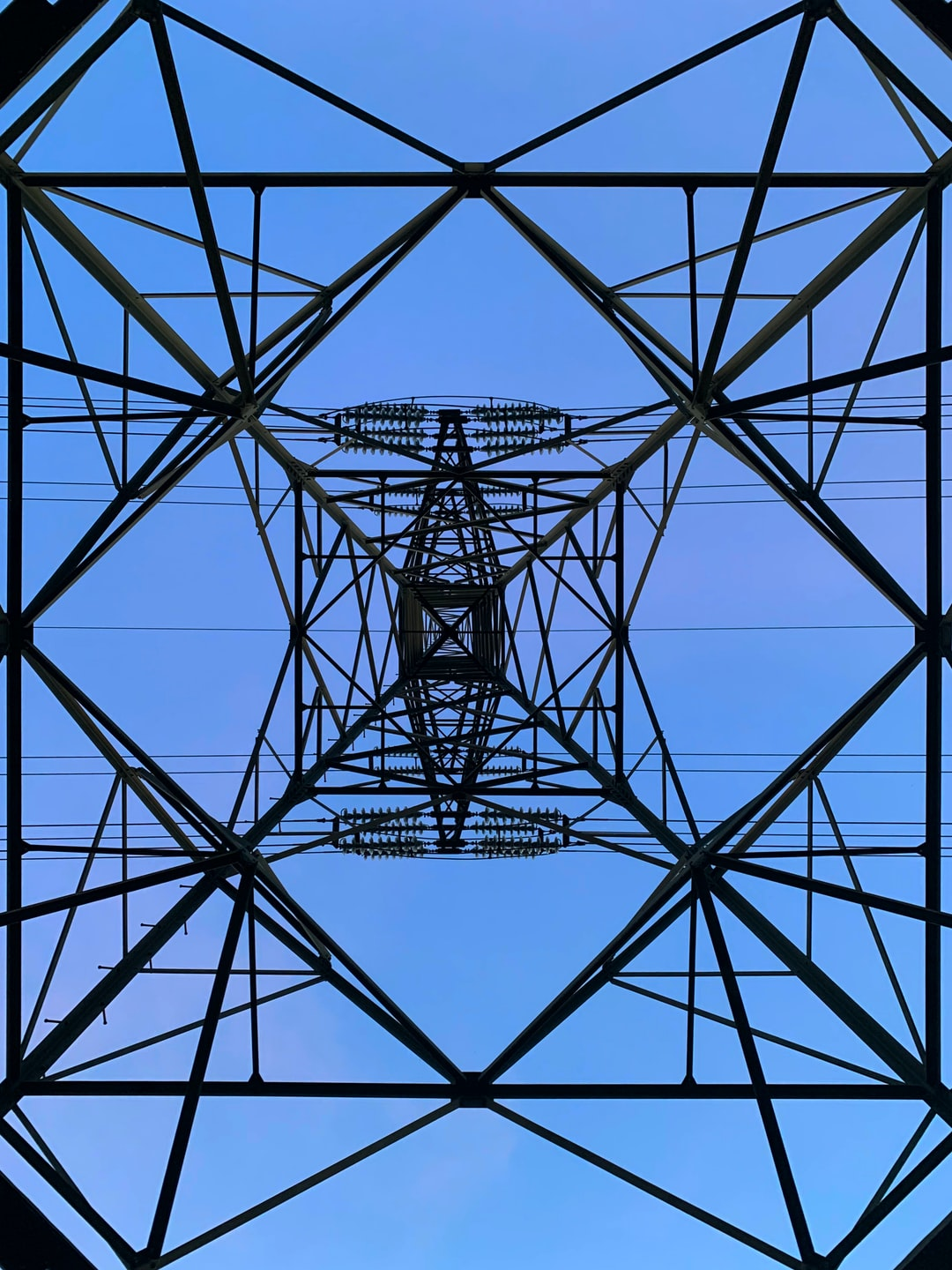 Wire tower for electricity. Architecture from below. High voltage.