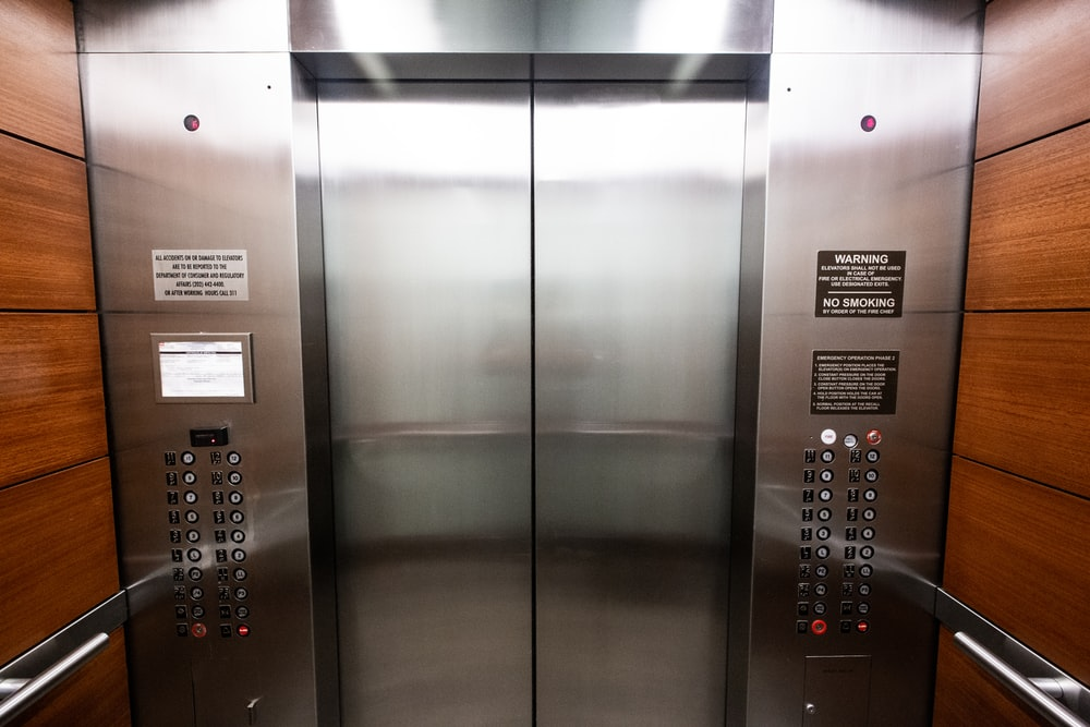 stainless steel elevator door with buttons