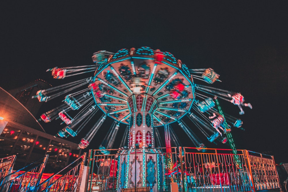 red and blue ferris wheel during night time