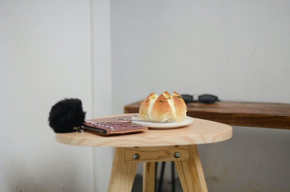 bread on white ceramic plate on brown wooden table