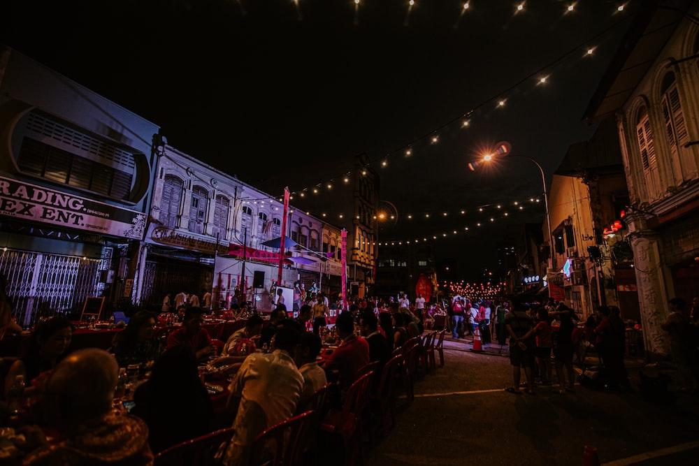 people gathering on street during night time