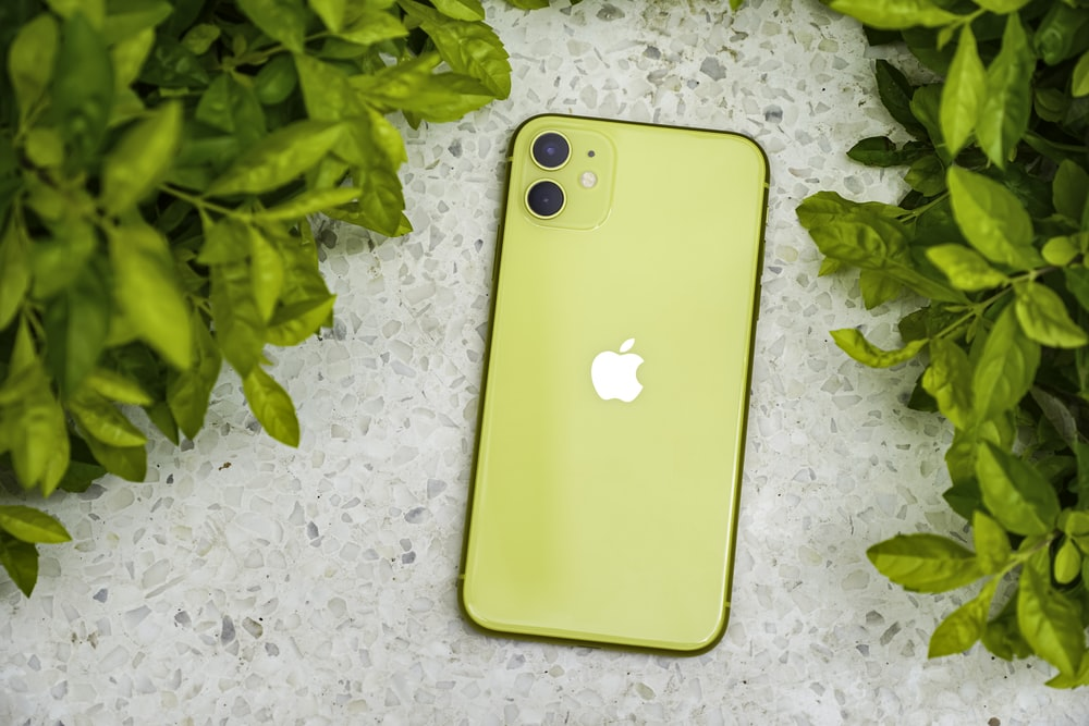 yellow iphone case on white textile