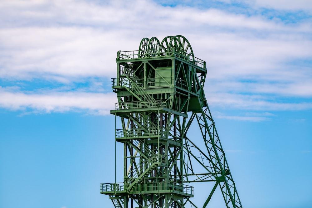 black metal tower under blue sky