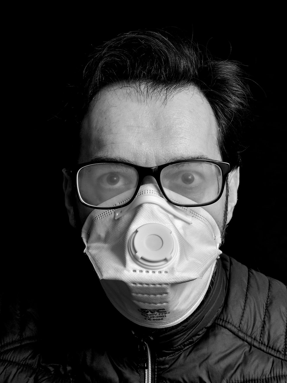 grayscale photo of person wearing eye mask