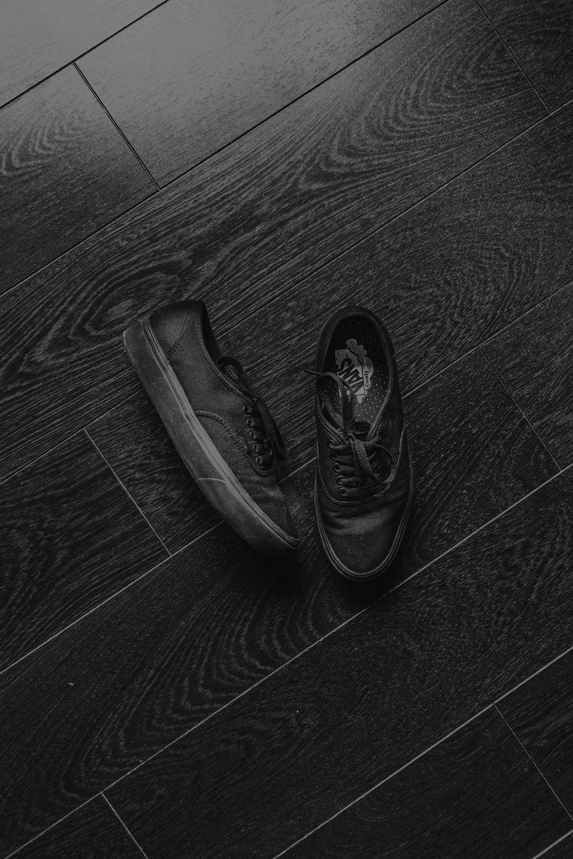 black leather shoes on black wooden floor
