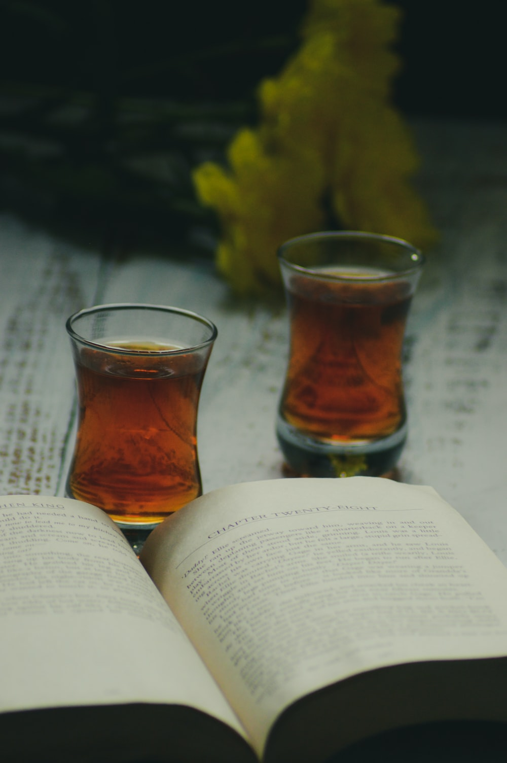clear shot glass on book page