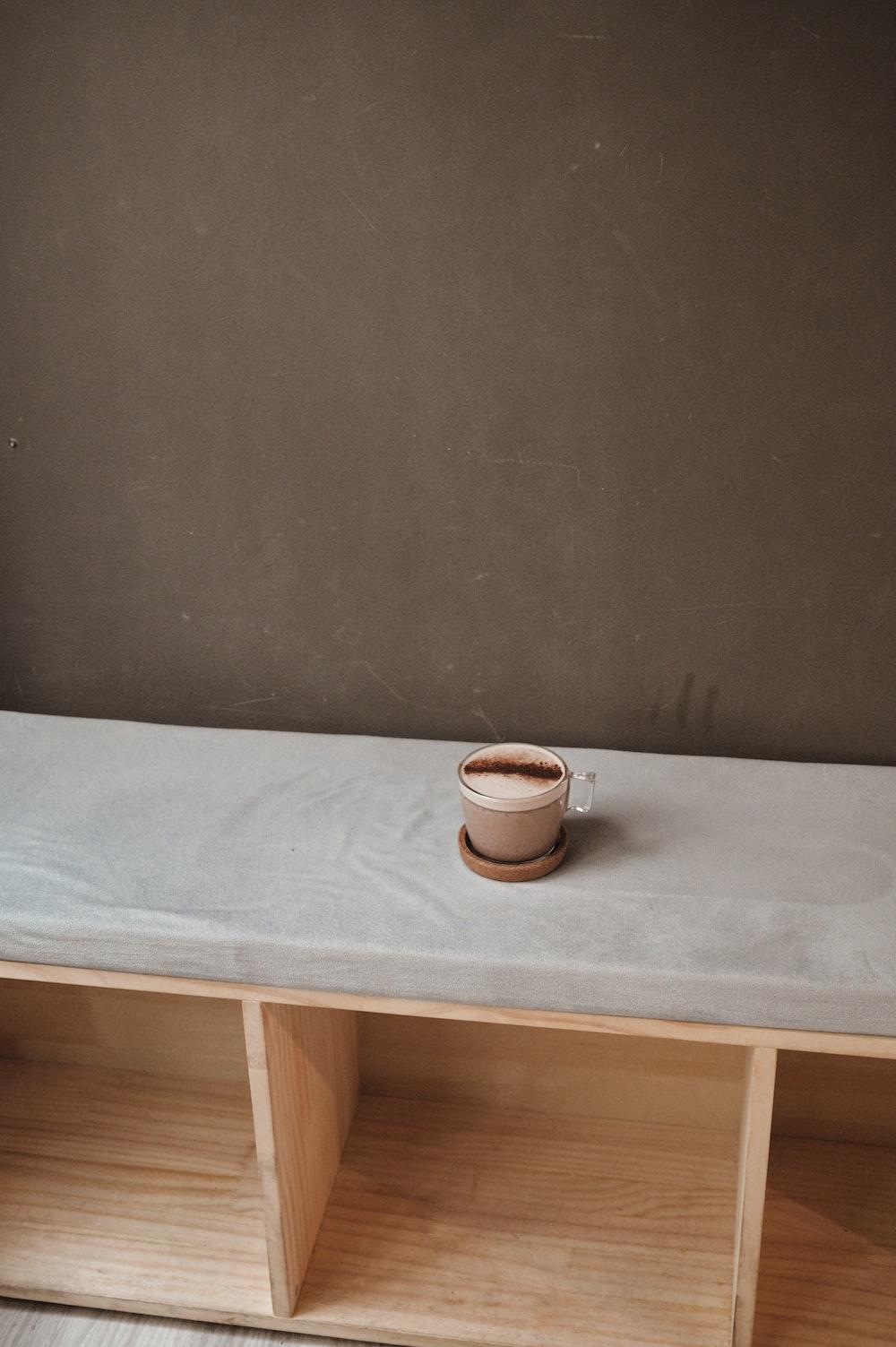 white ceramic mug on white ceramic saucer on white table