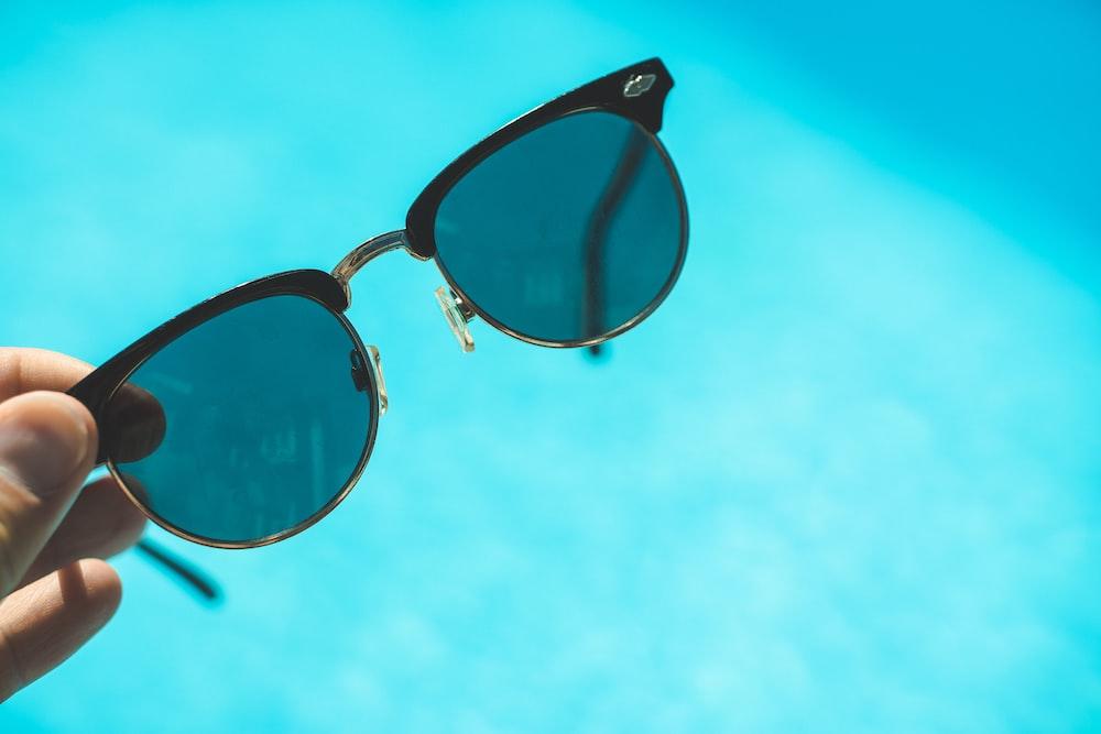 black framed sunglasses under blue sky during daytime
