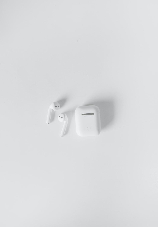 white apple earpods on white surface
