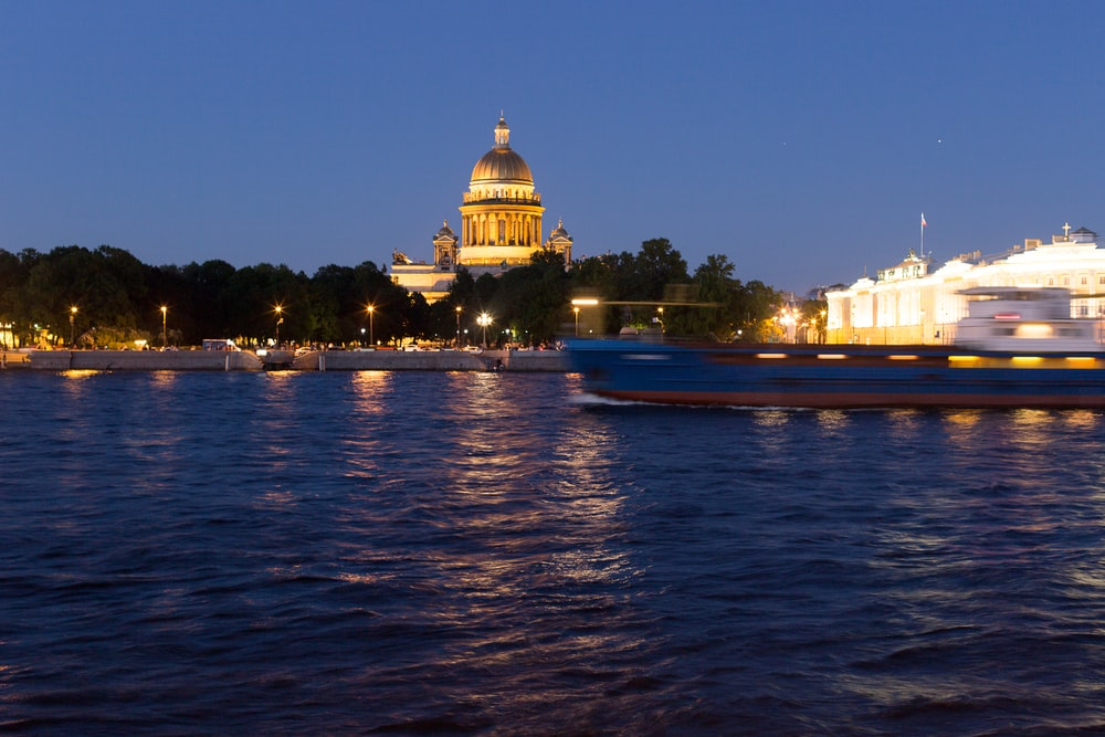 white and brown dome building near body of water during night time