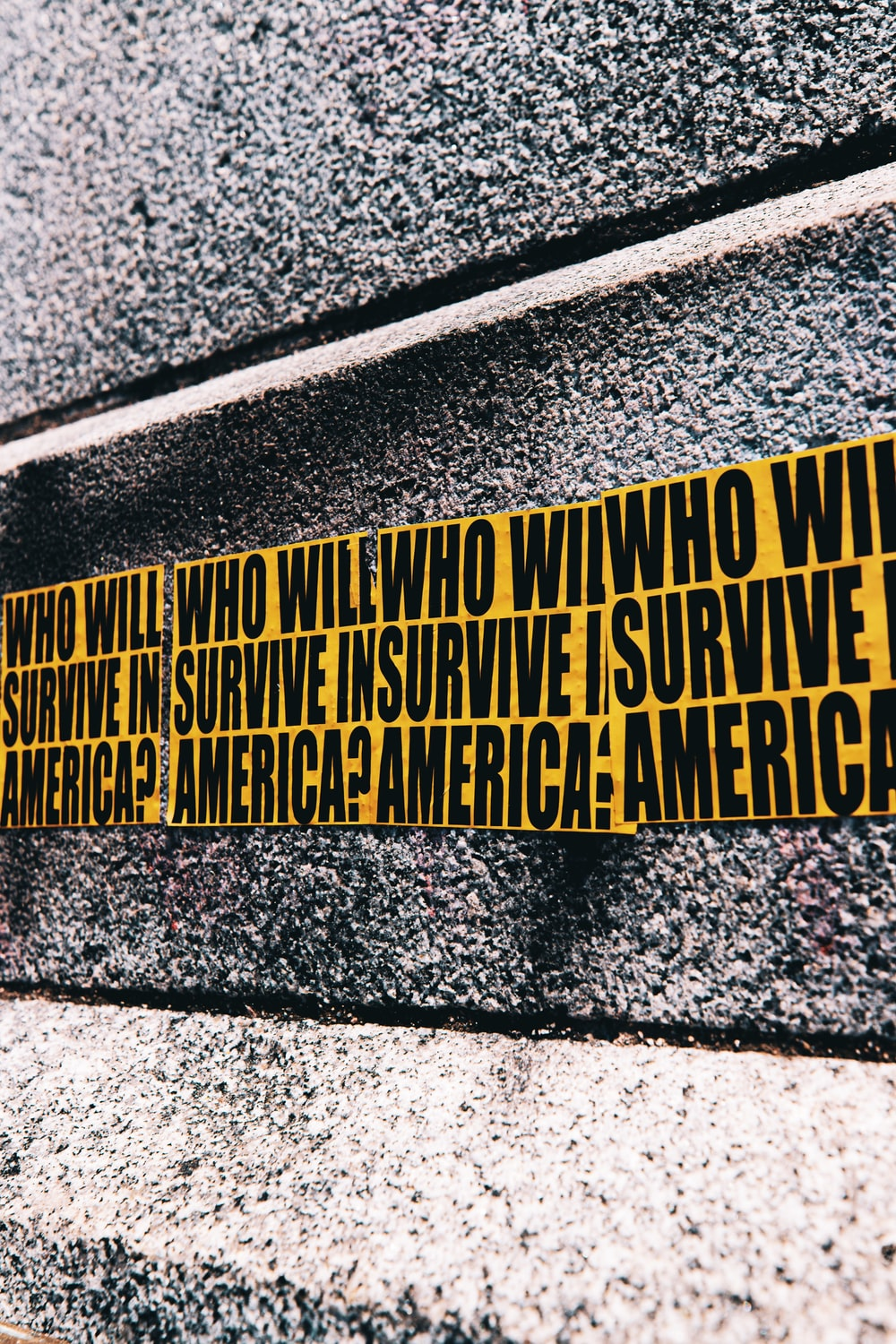 yellow and black quote on gray concrete wall