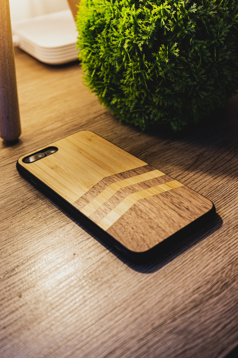 black iphone 7 on brown wooden table