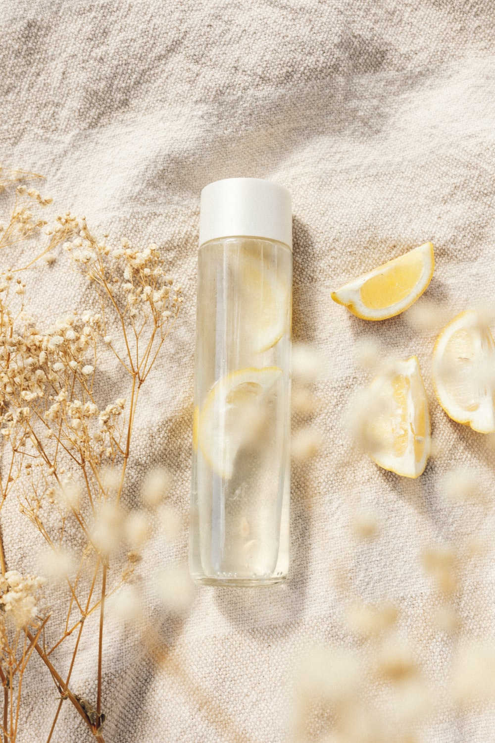clear glass bottle with white flowers
