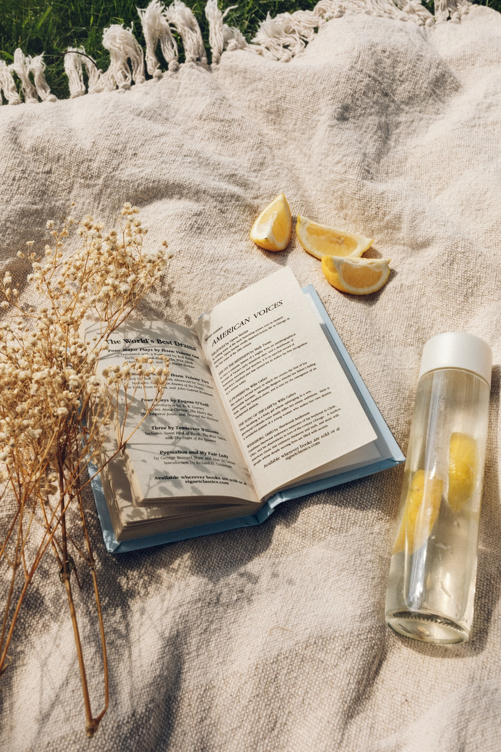 white book page beside clear glass bottle