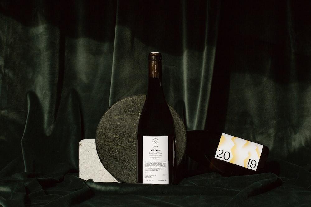 black wine bottle on black textile