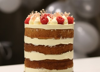 brown and white cake with strawberry on top