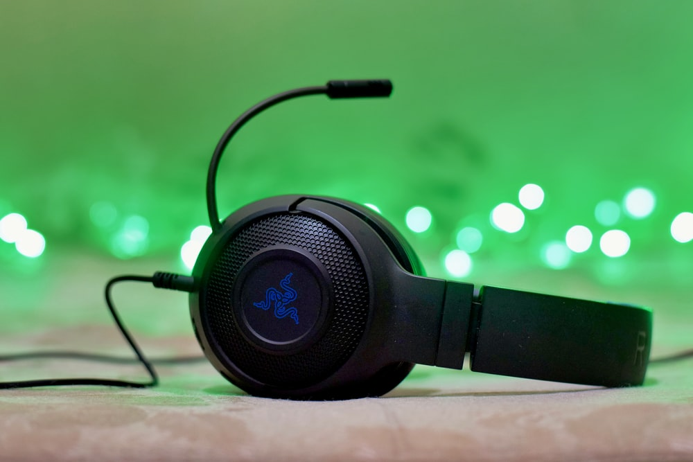 black and blue headphones on brown wooden table