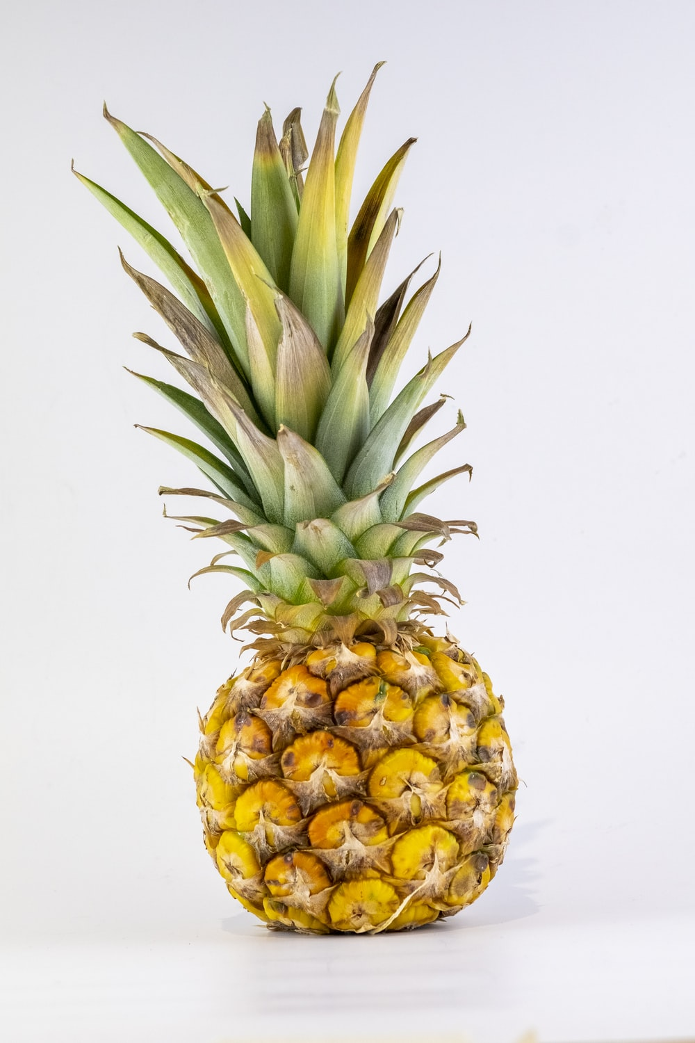 pineapple fruit on white table