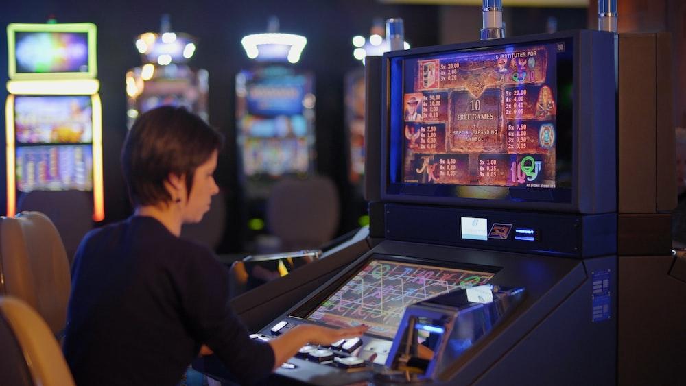 woman in black long sleeve shirt playing arcade game