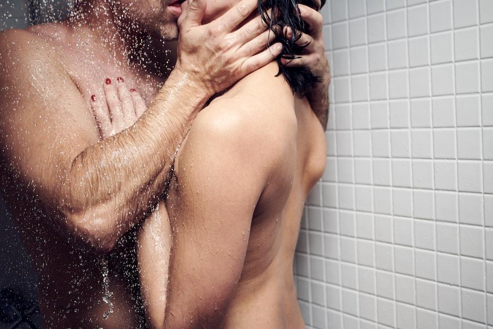 man and woman in bathtub
