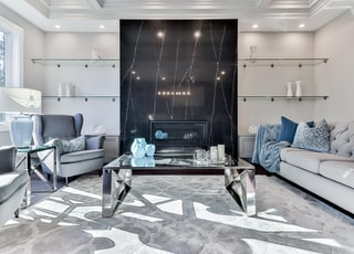 blue and white sofa near glass coffee table