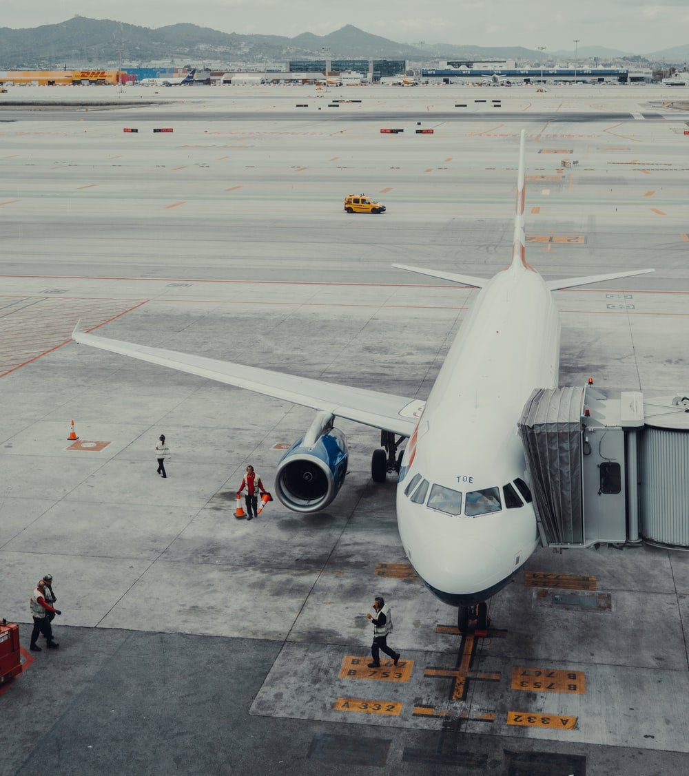 people walking on airport during daytime
