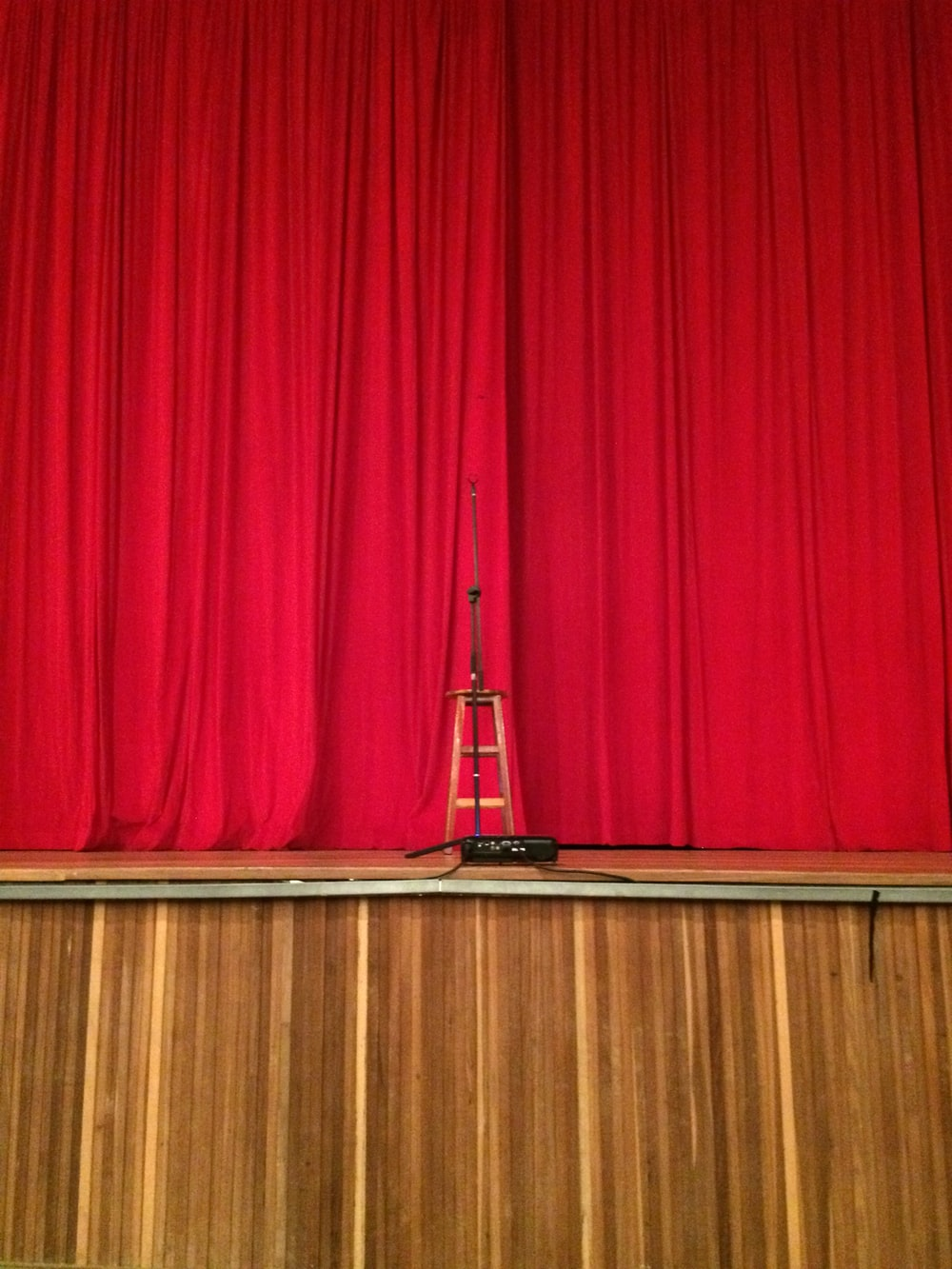 red curtain on brown wooden floor