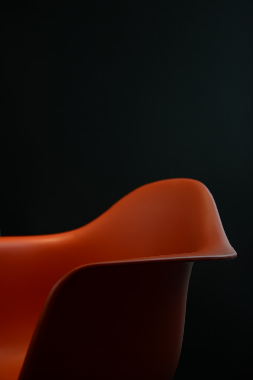 red plastic chair on black background