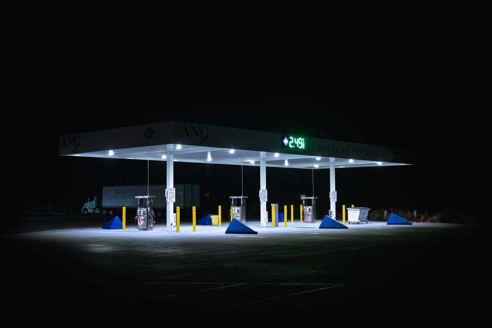 white and green gas station